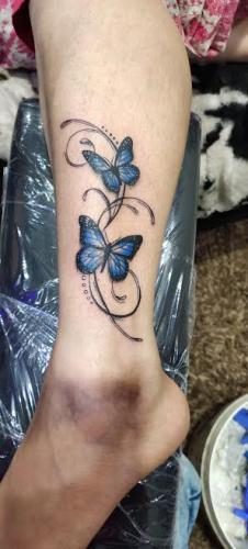 butterfly tatoo leg